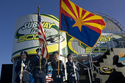 The Arizona flag and the American flag fly at the Subway Fresh Fit 500