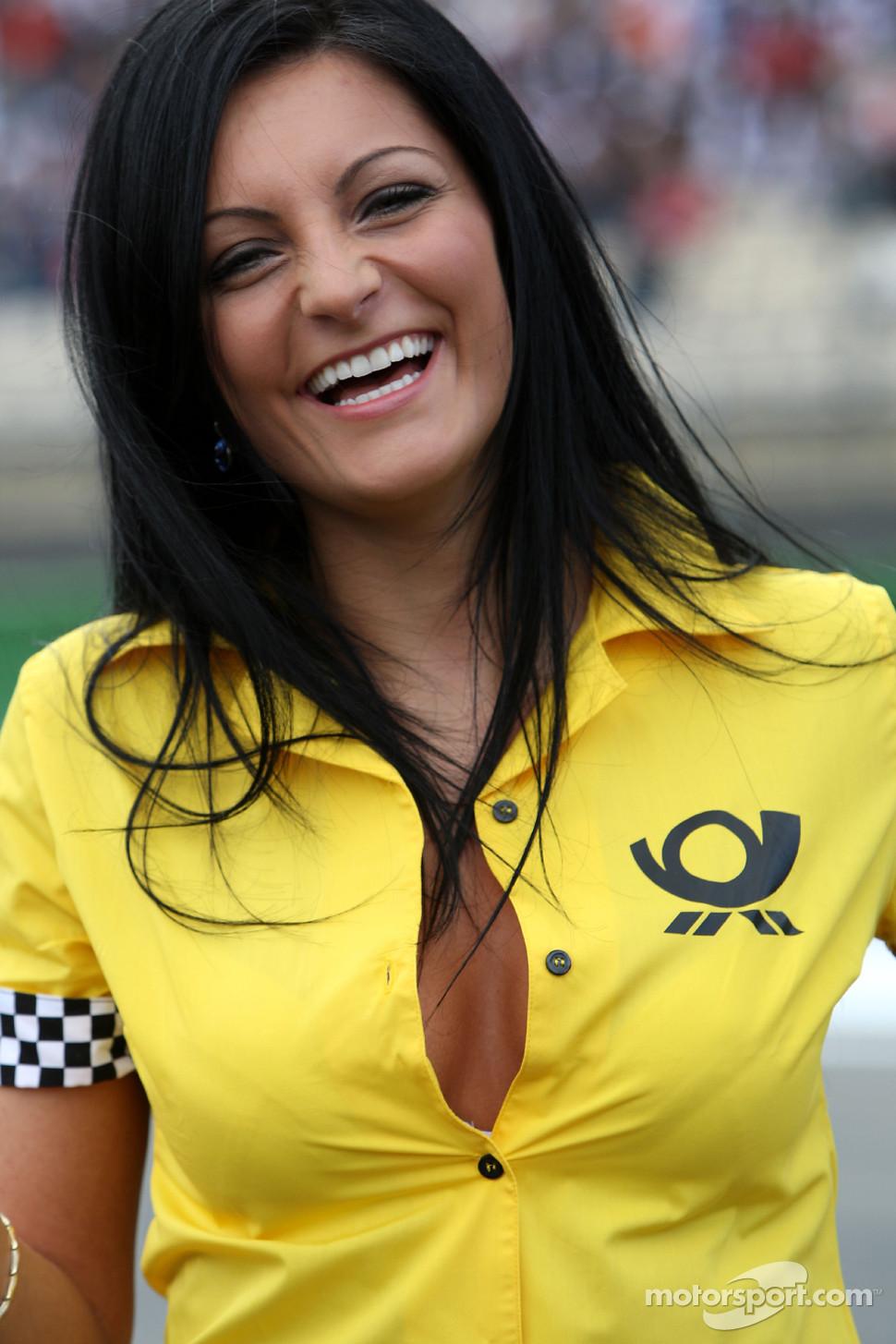 Deutsche Post grid girl buttoned up her shirt