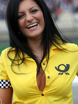 Deutsche Post grid girl buttoned up her shirt