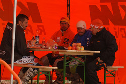 KTM team riders at the bivouac