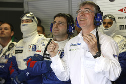 Michel Barge and Peugeot team members celebrate pole position