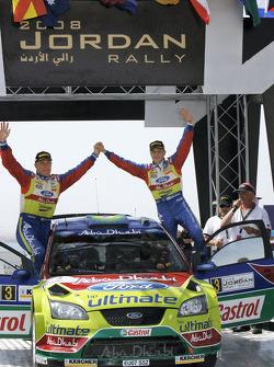Podium: rally winners Mikko Hirvonen and Jarmo Lehtinen celebrate