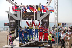Podium: rally winners Mikko Hirvonen and Jarmo Lehtinen, second place Daniel Sordo and Marc Marti, third place Chris Atkinson and Stéphane Prévot
