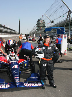 A happy race fan poses after taking laps in the Indy Racing Experience two-seater
