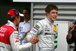 Timo Scheider, Audi Sport Team Abt, congratulates Paul di Resta, Team HWA AMG Mercedes, with his pole position
