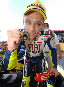 Race winner Valentino Rossi celebrates his 90th career victory