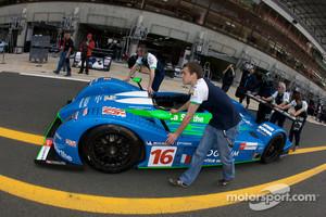 Henri Pescarolo and Pescarolo Sport team members push car to scrutineering