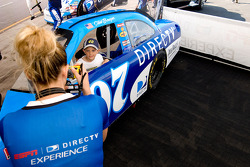 A young NASCAR fan gets his picture taken while going through the Direct TV Experience tent
