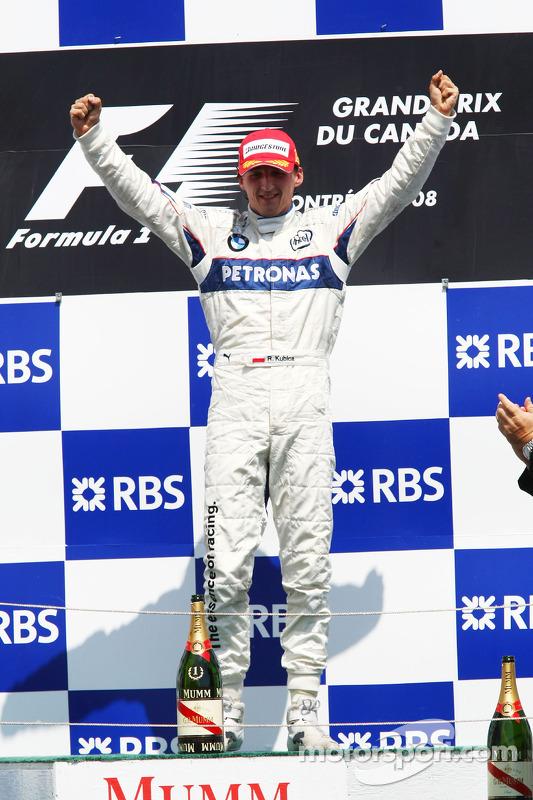 Podium: race winner Robert Kubica celebrates