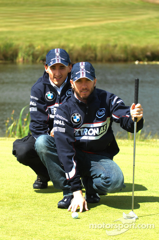 BMW Sauber F1 Team drivers Nick Heidfeld and Robert Kubica play golf at the Whittlebury Park Golf Cl