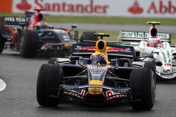 Mark Webber, Red Bull Racing leads Rubens Barrichello, Honda Racing F1 Team