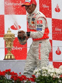 Podium: race winner Lewis Hamilton