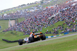 Jonathan Cochet demonstrates the Renault R26 for the crowd at Donington
