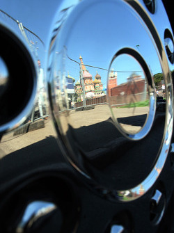 The Kremlin mirrored in a wheel of a truck