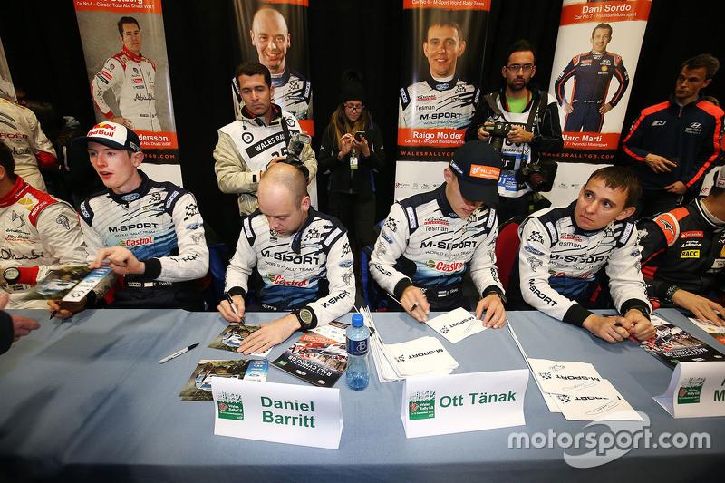 Ott Tanak and Molder Raigo with Elfyn Evans and Daniel Barrit, M-Sport  sign autographs for the fans