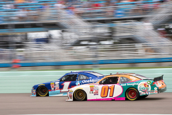 Landon Cassill, JD Motorsports Chevrolet and Elliott Sadler, Roush Fenway Racing Ford