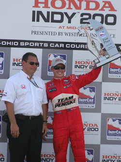 Podium: race winner Ryan Briscoe celebrates