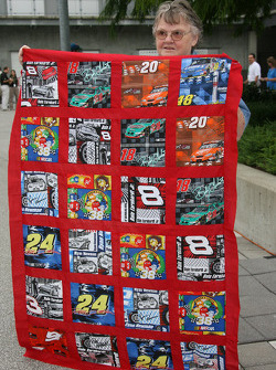 A devoted fan displays her quilt covered with NASCAR drivers