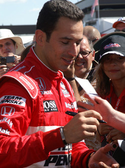 Helio Castroneves signs autographs