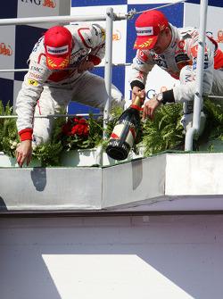 Podium: race winner Heikki Kovalainen, second place Timo Glock