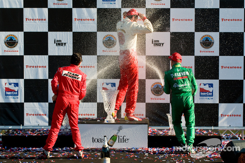 Podium: champagne for Justin Wilson, Helio Castroneves and Tony Kanaan