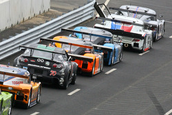 Cars line up on pitlane at the start of the session