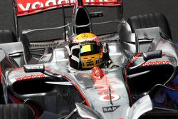 Race winner Lewis Hamilton celebrates
