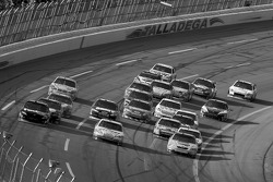 Denny Hamlin, Dale Earnhardt Jr. and Kyle Busch battle for the lead