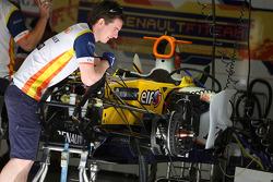 Mechanics work on the car of Fernando Alonso, Renault F1 Team