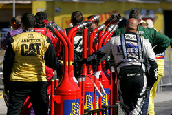 Crews wait to fill up thier gas cans during the race