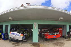 Jimmie Johnson and Carl Edwards make adjustments to their cars