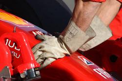 Ferrari mechanics wear rubber gloves, due to KERS on the car of Luca Badoer, Test Driver, Scuderia Ferrari