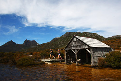 Launceston, Australia: Mark Webber and Emma Weitnauer run past the boat shed on their way to Cradle Mountain