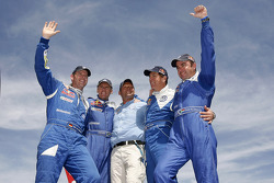 Car category winners Giniel De Villiers and Dirk Von Zitzewitz, celebrate with car category second place Mark Miller and Ralph Pitchford, and Volkswagen Motorsport director Kris Nissen