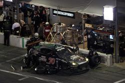 Pit stop for #70 SpeedSource Mazda RX-8: Jonathan Bomarito, Nick Ham, David Haskell, Sylvain Tremblay
