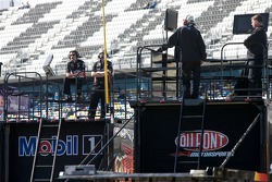 Crew chiefs watch practice action from atop their haulers