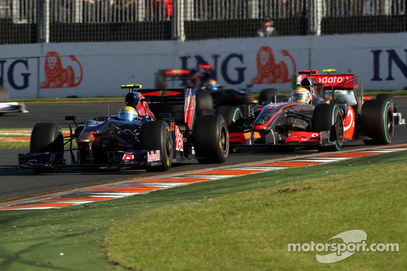 Sebastien Buemi, Scuderia Toro Rosso; Lewis Hamilton, McLaren Mercedes