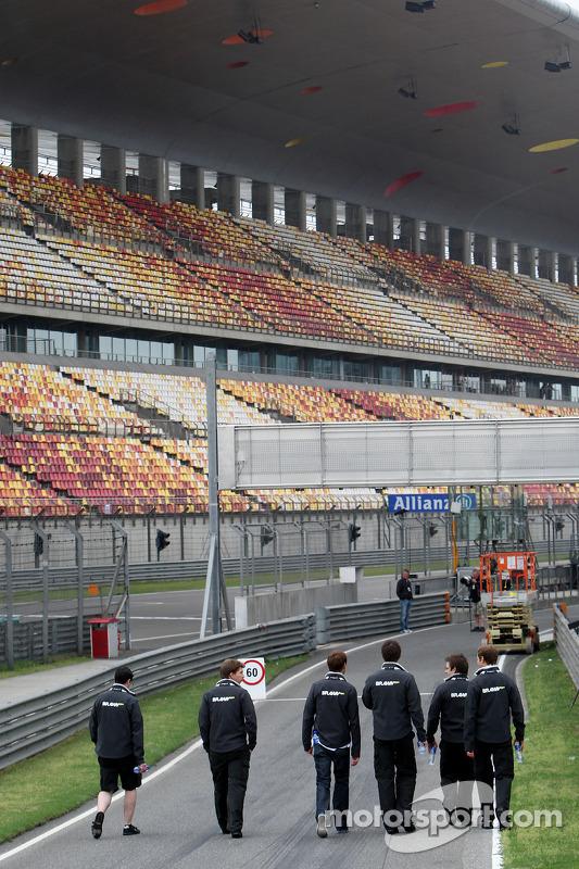 Jenson Button, Brawn GP, walks the circuit