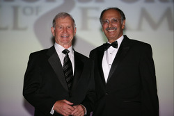 Racing legend Parnelli Jones presents Cary Agajanian, who accepted his late father, J.C.'s induction into the International Motorsports Hall of Fame