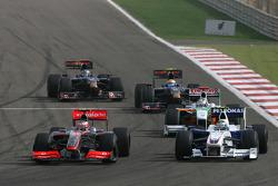 Heikki Kovalainen, McLaren Mercedes y Nick Heidfeld, BMW Sauber F1 Team