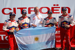 Winners Sébastien Loeb and Daniel Elena, Citroen C4, Citroen Total World Rally Team, second place Daniel Sordo and Marc Marti celebrate with Citroen Total World Rally Team boss Olivier Quesnel