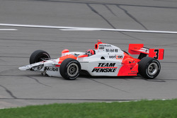 Helio Castroneves, Penske Racing with damage