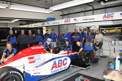 Vitor Meira poses with  A.J. Foyt and A.J. Foyt Enterprises team members