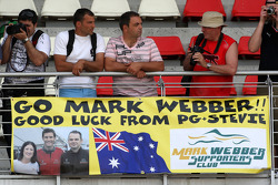 Banners in the crowd for Mark Webber, Red Bull Racing
