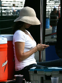 Ashley Judd takes time to text from the pit lane