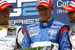 Edoardo Mortara celebrates his first GP2 Series victory on the podium with Romain Grosjean and Jerome D'Ambrosio