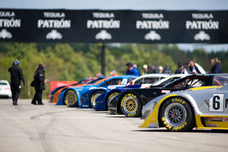 Race cars wait on the track prior to the start of the race