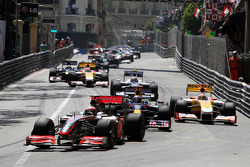 Heikki Kovalainen, McLaren Mercedes leads Mark Webber, Red Bull Racing