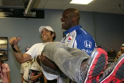 Grand Marshal Shaquille O'Neal lifts Luczo Dragon driver Raphael Matos