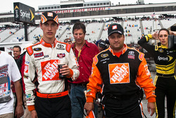 Race winner Joey Logano, Joe Gibbs Racing Toyota and crew chief Greg Zipadelli walk to victory lane